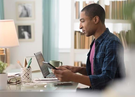 Man working from home using Paylocity's Modern Workforce Platform