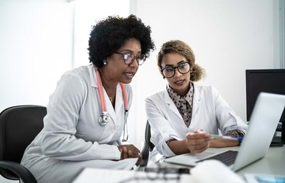 Two medical professional collaborating.